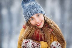 Winter young woman portrait. Beauty Joyful Model Girl laughing and having fun in winter park. Beautiful young female royalty free stock photography