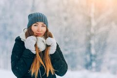 Winter young woman portrait. Beauty Joyful Model Girl laughing and having fun in winter park. Beautiful young woman. Laughing outdoors. Enjoying nature royalty free stock photography