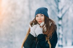 Winter young woman portrait. Beauty Joyful Model Girl laughing and having fun in winter park. Beautiful young woman. Laughing outdoors. Enjoying nature royalty free stock images