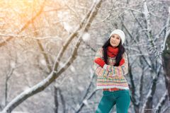 Winter young woman portrait. Beauty Joyful Model Girl laughing and having fun in winter park. Beautiful young woman. Laughing outdoors. Enjoying nature Stock Photography