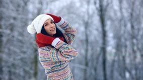 Winter young woman portrait. Beauty Joyful Model Girl laughing and having fun in winter park. Beautiful young woman stock video