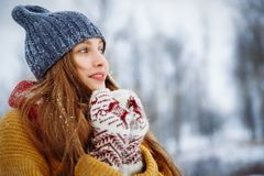 Winter young woman portrait. Beauty Joyful Model Girl laughing and having fun in winter park. Beautiful young female royalty free stock photo