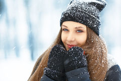Winter young woman portrait. Beauty Joyful Model Girl laughing and having fun in winter park. Beautiful young woman Royalty Free Stock Images