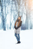 Winter young woman portrait. Beauty Joyful Model Girl laughing and having fun in winter park. Beautiful young woman Stock Photo