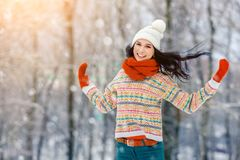 Winter young woman portrait. Beauty Joyful Model Girl laughing and having fun in winter park. Beautiful young woman. Laughing outdoors. Enjoying nature Royalty Free Stock Image