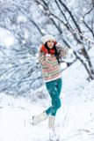 Winter young woman portrait. Beauty Joyful Model Girl laughing and having fun in winter park. Beautiful young woman. Laughing outdoors. Enjoying nature Royalty Free Stock Photo