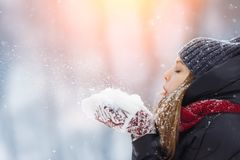 Winter young woman portrait. Beauty Joyful Model Girl laughing and having fun in winter park. Beautiful young female stock image