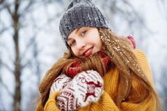 Winter young woman portrait. Beauty Joyful Model Girl laughing and having fun in winter park. Beautiful young female royalty free stock photos