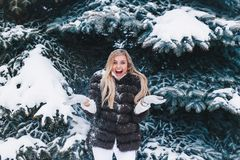 Winter young woman portrait. Beauty Joyful Model Girl laughing and having fun in winter park. Beautiful young woman royalty free stock photography
