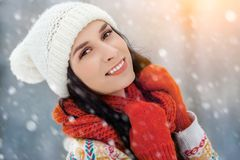 Winter young woman portrait. Beauty Joyful Model Girl laughing and having fun in winter park. Beautiful young woman. Laughing outdoors. Enjoying nature Royalty Free Stock Photos