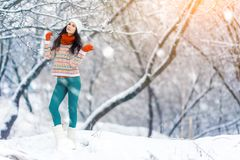 Winter young woman portrait. Beauty Joyful Model Girl laughing and having fun in winter park. Beautiful young woman. Laughing outdoors. Enjoying nature Stock Images