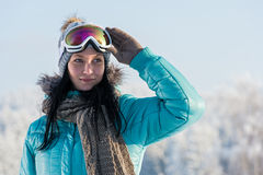 Winter young woman with ski goggles snow Royalty Free Stock Photography