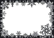 Winterfeld mit Schneeflocken Stockbilder