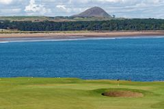 Winterfield Golf Course. A view looking over the 16th Green at Winterfield Golf course in Dunbar Scotland, with Belhaven Bay in the background Stock Image