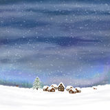 Winterhimmel und kleines Dorf Stockfotografie
