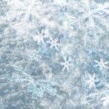 Winterhintergrund von den Schneeflocken Lizenzfreie Stockbilder