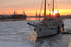 Wintering sailship at sunset stock photo