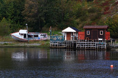 Winterized fishing dock and cabins in Quidi Vidi Harbor, Newfoundland. In the early October (beginning of the fall) already winterized fishing boat, dock and Royalty Free Stock Photos