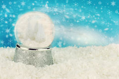Winterland Snow Globe. Snow globe with snow covered pine trees inside. Copy space available royalty free stock photos
