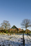 Winterlandscape with farmhouse Royalty Free Stock Images