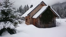 Wood house in Snow. Winterlandscape Woodhouse in Snow. Anybody at Home Stock Images