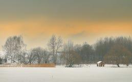 Winterlandschaft am Sonnenuntergang Stockbild