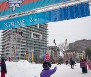 Winterlude в Gatineau, Квебеке, Канаде 2014 - застежка-молния Linin детей Стоковая Фотография