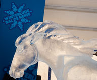 Winterlude in Ottawa, Ontario, Canada 2014 - Ice Horse. A sculpture of a horse carved from Ice with the Winterlude symbol in Ottawa, Ontario, Canada Stock Images