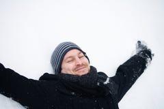 Winterman enjoying the snow Royalty Free Stock Photo