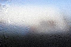 Wintermuster von Eiskristallen auf Glas Lizenzfreies Stockbild