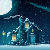 Winternacht mit einem fabelhaften Haus und einer Laterne Stockbild