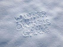 Winterolympiade - Schreiben im Schnee lizenzfreie stockfotos