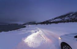 Winterroad Kvaløya Nord-Norwegen Stockfotografie