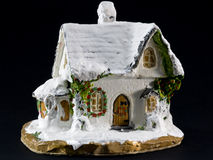 Winters christmas decoration with small toy ceramic house Royalty Free Stock Photo