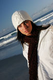 Winters coming. Young woman rugged up at the beach Royalty Free Stock Image