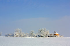 A winters day. An isolated country house on a snowy winter day Stock Image