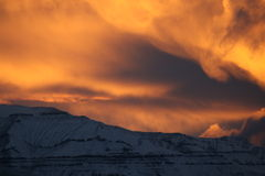 Winters day in Greenland. Clouds goes crazy when sun sets in Uummannaq Royalty Free Stock Photos