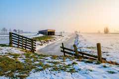 Winters deLight. Typical Dutch winter scene, snow is mostly melting but the memory of the fun remains Royalty Free Stock Photos