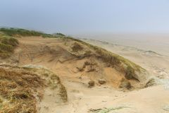 Dune landscape Dutch coast with sand drifts and wind eroded deep holes. Winters dune landscape Dutch coast with by autumn storms deep carved out  wind holes Royalty Free Stock Photos