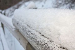 Winters grip. This is some snow on the top of a railing stock photos