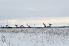 Winters industrial landscape. Oil derricks on a winters field Royalty Free Stock Photos