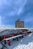 Winters pathway ballybunion castle red benches Stock Photography
