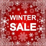 Winterschlussverkauf auf dem roten Hintergrund Stockfoto