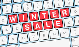 Winterschlussverkauf auf Laptoptastatur mit Schnee Lizenzfreie Stockfotos