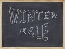 Winterschlussverkauffleisch geschrieben auf eine Tafel Lizenzfreies Stockfoto