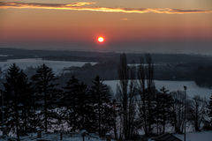 Wintersonnenaufgang in Polen Stockbild
