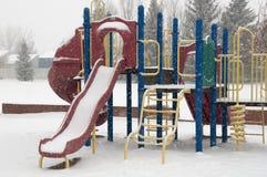 Winterspielplatzgeräte, Dias Lizenzfreies Stockfoto