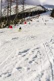Wintersporten op piste Stock Foto's