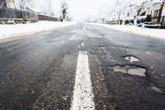 Winterstraßenschaden Stockbilder