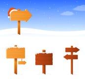 Winterthemafahne mit einem Holzschildbrett Lizenzfreie Stockbilder